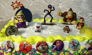 Unique Super Mario Brothers 15 Piece Cake Topper Set Featuring 6 Mario Figures Including Donkey Kong, Boo Ghost, Wario, Goomba, Diddy Kong and Waluigi, 1 Large Bomb Cake Decoration, 6 Super Mario Buttons, and 2 Mario Gold Coins Toys & Games